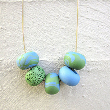 NL-186 Sea Blue and Grass Green Swirl Patchy Pattern and Textured Donut-shaped Clay Beads Necklace in Adjustable Ecru Colour Leather Cord