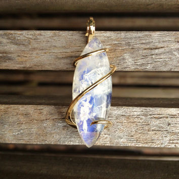 moonstone cut and polished and tension set in hand forged polished 14 karat gold