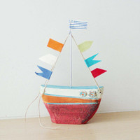 Ceramic sailing boat with colourful flags, stoneware clay boat outline sculpture with wire mast and fabric flags