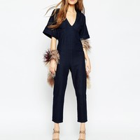 ASOS Denim Straight Leg Jumpsuit With V-Neck And Wide Sleeve In Indigo
