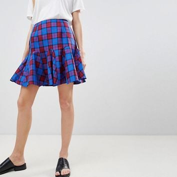 ASOS DESIGN tailored blue and red check mini skirt with godet hem at asos.com