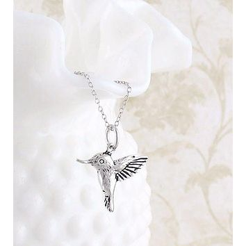 Tiny Hummingbird Necklace in Sterling Silver