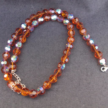 Lovely vintage single strand amber aurora borealis facetted crystal necklace. Ideal , anniversary, birthday gift.