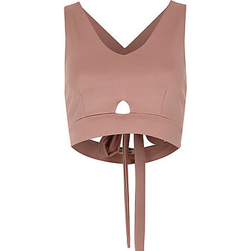 Light pink cut out strappy back crop top