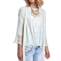Ecru open knit jacket with fringing