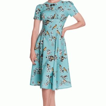 Be sweetly unique in this Summer Floral & Birdy Print Retro Dress by Hell Bunny. This short sleeves retro style dress features a classic a-line cut, false collar with antique gold color buttons, a round neckline, yellow black and white birds on black and w