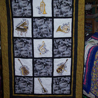 """Musical Instruments, Embroidered , Couch/Lap Quilt.  67 1/2"""" X 45 1/2""""."""