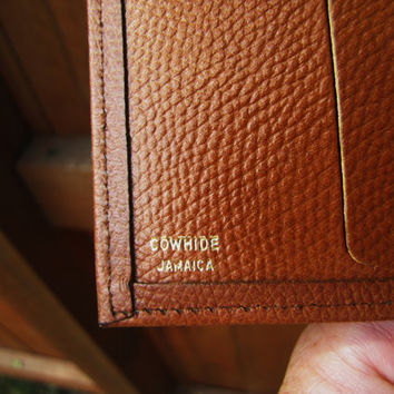 vintage cognac pebbled leather wallet. English Leather. cowhide Jamaica. fully lined. sold AS IS