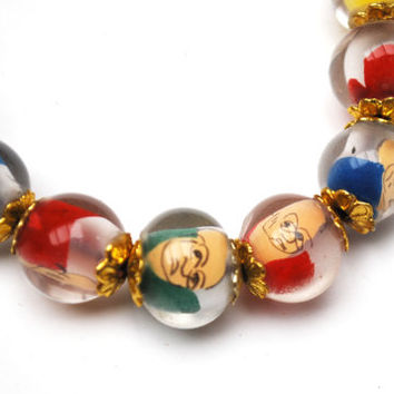 Vintage Lucite bead  Stretch Bracelet. Fun colorful Caricature man face vintage Beads mid century