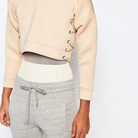 Story Of Lola | Story Of Lola Neoprene Cropped Sweatshirt With Lace Up Side Detail at ASOS
