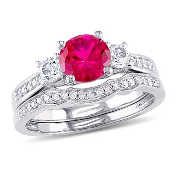 6.0mm Lab-Created Ruby and White Sapphire with 1/8 CT. T.W. Diamond Three Stone Bridal Engagement Ring Set in 14K White Gold