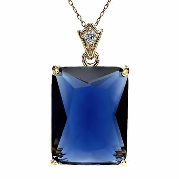 "Gold Plated Emerald Cut Simulated Sapphire and Zirconia Pendant With 18"" Chain"