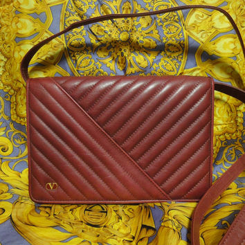 Vintage Valentino Garavani wine burgundy leather clutch shoulder bag with V stitches and golden motif. Classic purse
