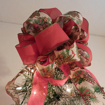 Lg Xmas tree topper bow w/ white burlap ribbon, pinecones, evergreen branches, a red burlap ribbon w/ grn trim (8 ft. tails)