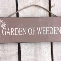 Garden Sign. Garden of weeden.