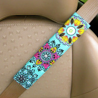 Seat Belt Cover-  Vibrant Floral Print on Turquoise Background with Reversible Turquoise, Green, and White Chevron.