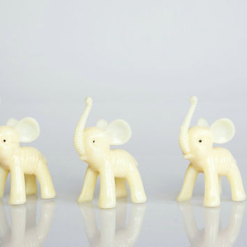 White plastic elephant figurines, vintage elephant decor, starved elephant figures, elephant lover gift, skinny animals, quirky elephant set