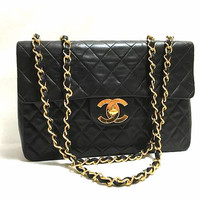 Vintage CHANEL black lamb extra large, jumbo , classic flap shoulder bag with golden CC closure. 2.55 classic purse.
