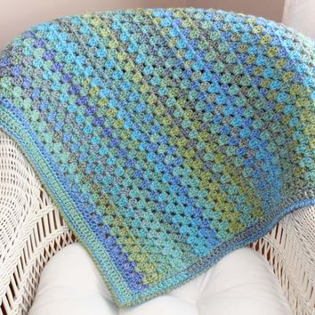 Shades of blue and green hand crocheted baby blanket.