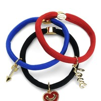 Red Set Of 3 Charmy Elastics by Juicy Couture, O/S