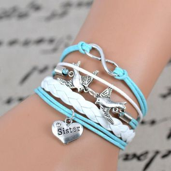 PEAPUG3 silver tone Peace Dove infinity charm bracelet,sister charm ,light blue white leather bracelet. = 1932519492