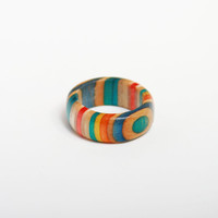 Custom, Multi-Color Recycled Skateboard Ring. Made in the USA from Colorful Used Skateboards.