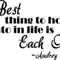 The best thing to hold onto in life is each other. Audrey Hepburn wall art wall sayings