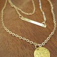 Gold plated 3 layers necklace with rounded charm and plaque.