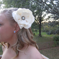 handmade fabric magnolia flower hair fascinator /sash pin in a lovely ivory satin fabric with a romantic pearl button center