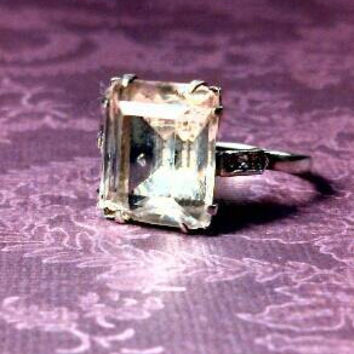 Old clear glass emerald cut sterling silver ring with rhinestones. Size 7.