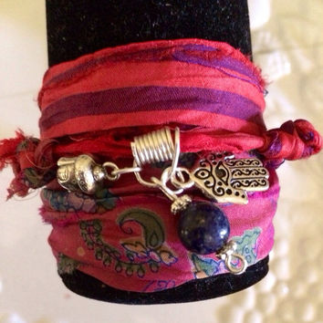 Silk sari ribbon with hamsa, buddah and lapis lazuli charm