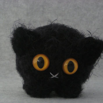 Crocheted black plush kitty
