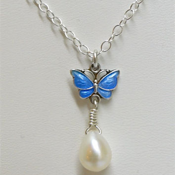 Blue enamel butterfly, pearl pendant necklace. Rare shaped pearl. Denmark Sterling. Volmer Bahner