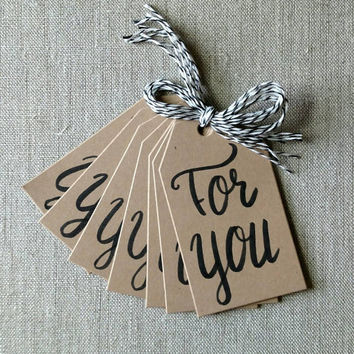 "Set of 8 handmade gift tags, each is hand lettered on Kraft tags, all 8 say ""For you"", comes with 8 pieces of black and white baker's twine."