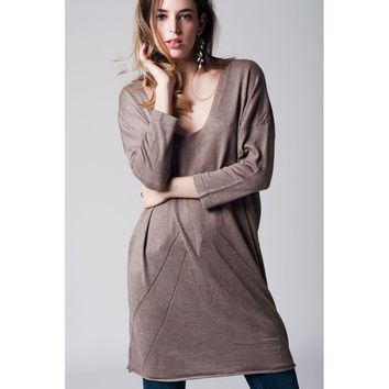 Beige long knit sweater with deep V neck