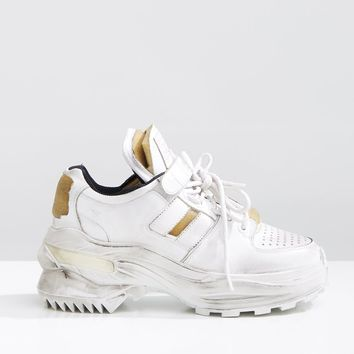Distressed Low-Top Sneakers by Maison Margiela- La Garçonne