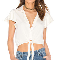 L'Academie x REVOLVE The Ruffle Sleeve Shirt in Ivory