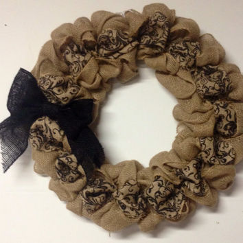 "22"" burlap wreath with black scroll design, black burlap bow. Front door wreath"