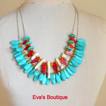 Statement necklace with teardrop shaped blue turquoise beads and large white coral,red coral and natural baltic amber