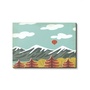 Tiny hot air balloon over mountains