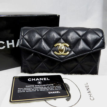 Vintage CHANEL black lambskin pouch bag for waist purse. Chic hip bag 2.55 classic type