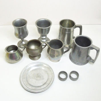 Assorted vintage pewter goblets pewter mugs tankards pewter creamers plate napkin rings - Movie props photo props restaurant decor