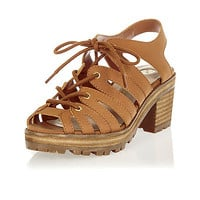 Brown lace-up chunky mid heel sandals