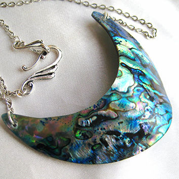 Paua abalone shell crescent necklace. Modern rainbow shell mermaid jewelry. Long, minimal, bold, statement. Green, blue, red, gold flash