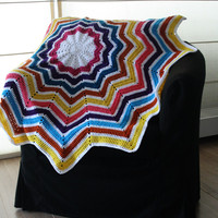 Crochet baby blanket and playmat: star shaped. Blue, teal, pink, yellow, orange, purple and white