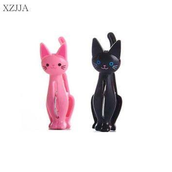 XZJJA 4Pcs/lot Creative Plastic Clothes Pegs Cute Cat Laundry Hanging Clothes Pins Beach Towel Clips Clamp Household Clothespins