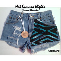 Hot Summer Nights Jean Shorts.  Levis Size Medium or 6. Gorgeous. Lots of wear, tears, rips.  Silver Spikes and Aztec black and teal.