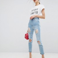 ASOS FARLEIGH High Waist Slim Mom Jeans In Sweet Mid Stonewash with Extreme Super Busts at asos.com