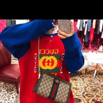 Red and blue spell color sweater that female models