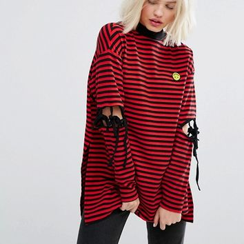 Lazy Oaf Long Sleeve Striped T-Shirt With Tie Up Elbows And Tiny Unhappy Face at asos.com